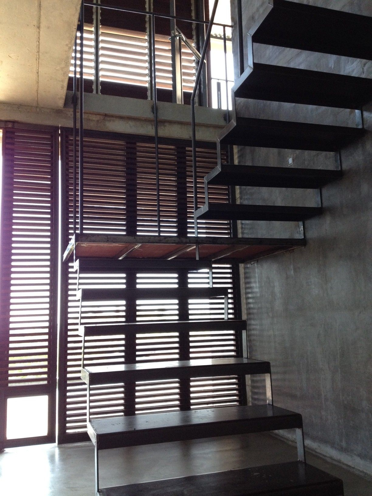 stairs at coy house, wood screen beyond