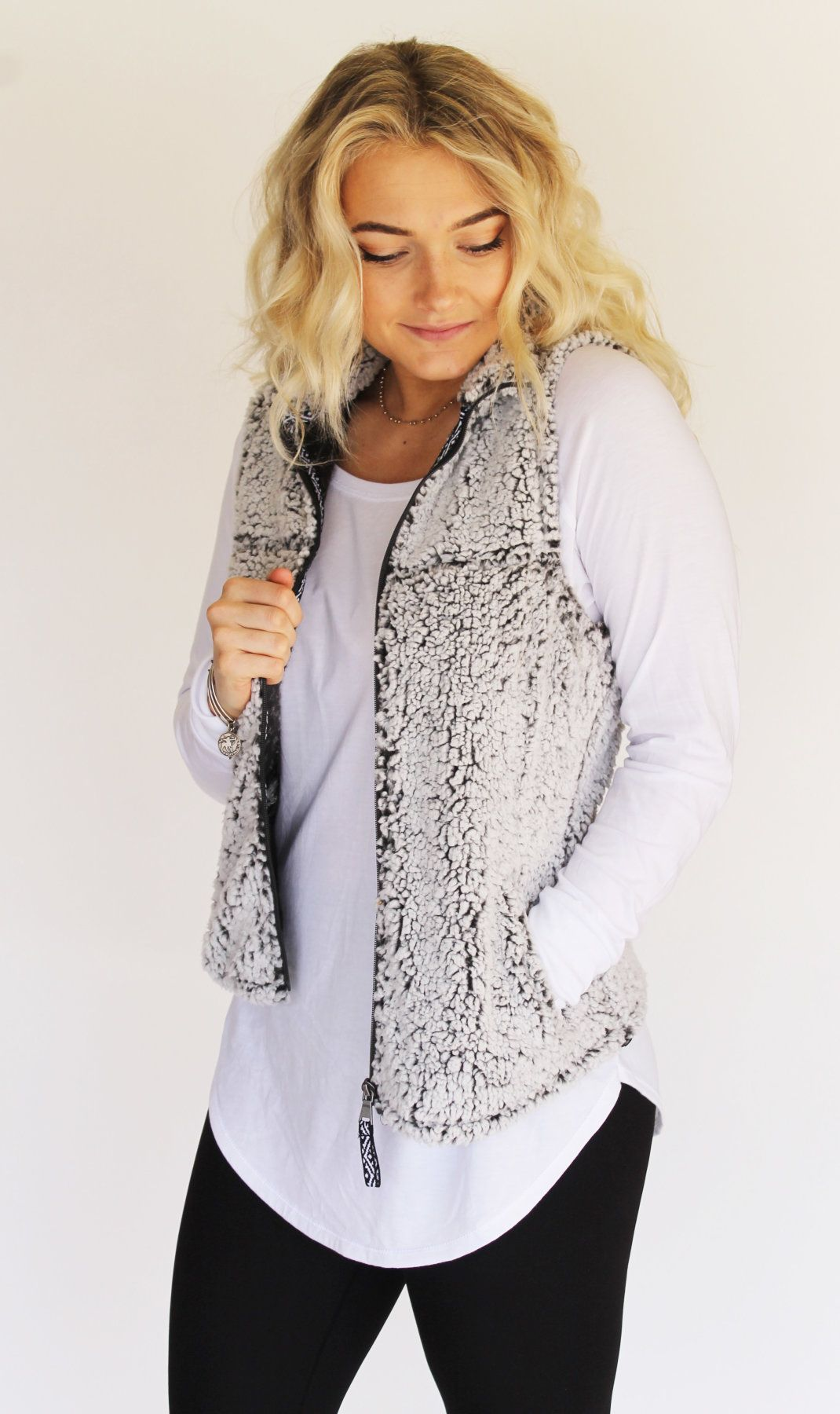 3b78bc910a9a2e This Sherpa Pullover Vest will become one of your favorites! The fabric is  so soft and comfortable