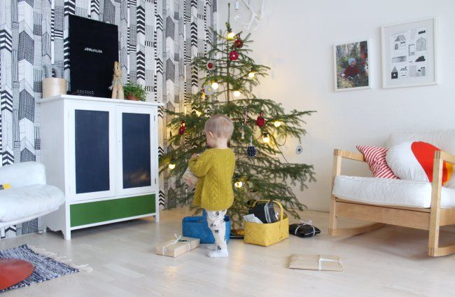 wallpaper, sweater kid, rocker, spindly christmas tree with big lights.