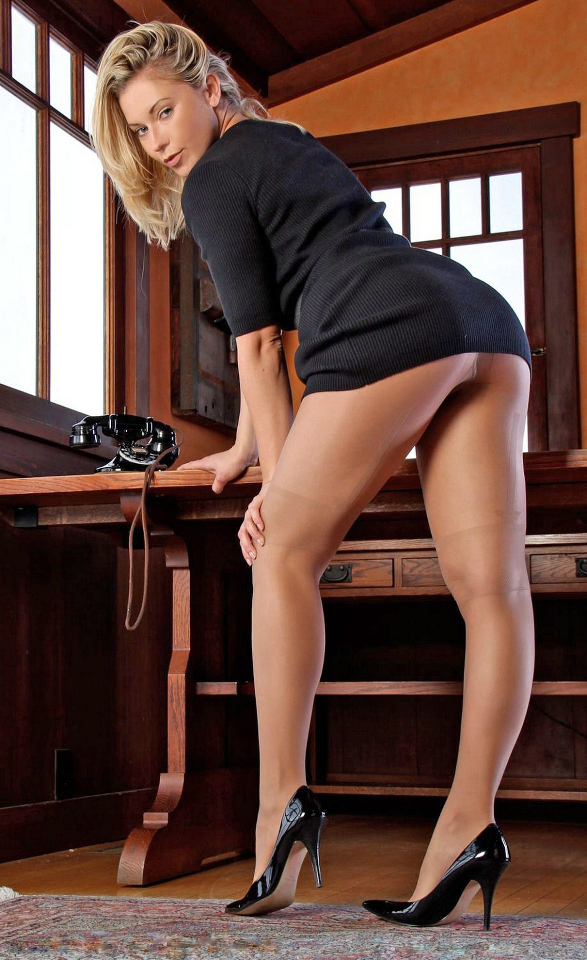 Stunning Blonde Woman in Stockings Heels Incredibly