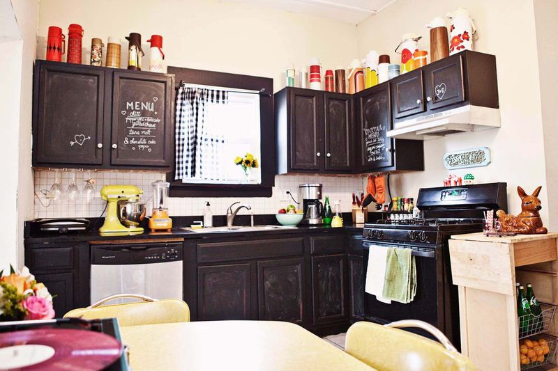 chalkboard paint on cabinets? i kinda like the idea.. maybe for just