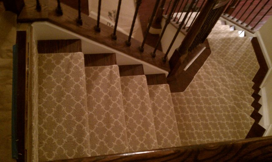 Carpet Runner On Oak Stair And Copper Patina Balusters.