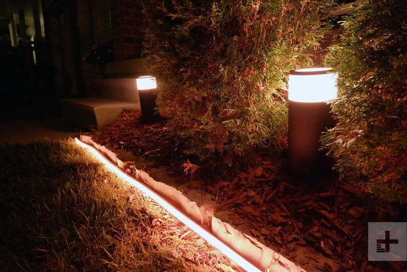 Philip Hue S Versatile Outdoor Light Strip Makes Drab Yards Holiday Decor Dazzle Hue Philips Outdoor Light Strips Garden Ideas Diy Cheap