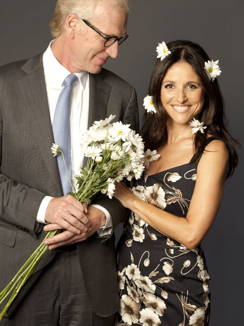 Love when a husband looks like that at his wife.  She just keeps getting prettier with time!  Floral done right.