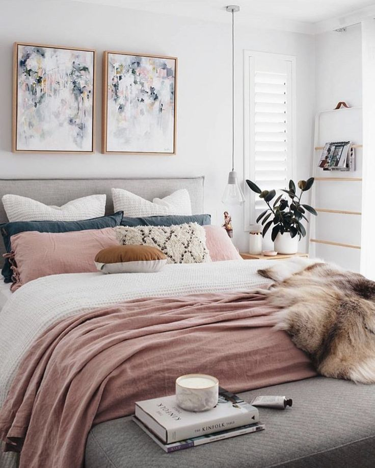 A chic modern bedroom with a white gray and blush pink color scheme the faux fur throw adds a touch of glamour to this contemporary girly room unique
