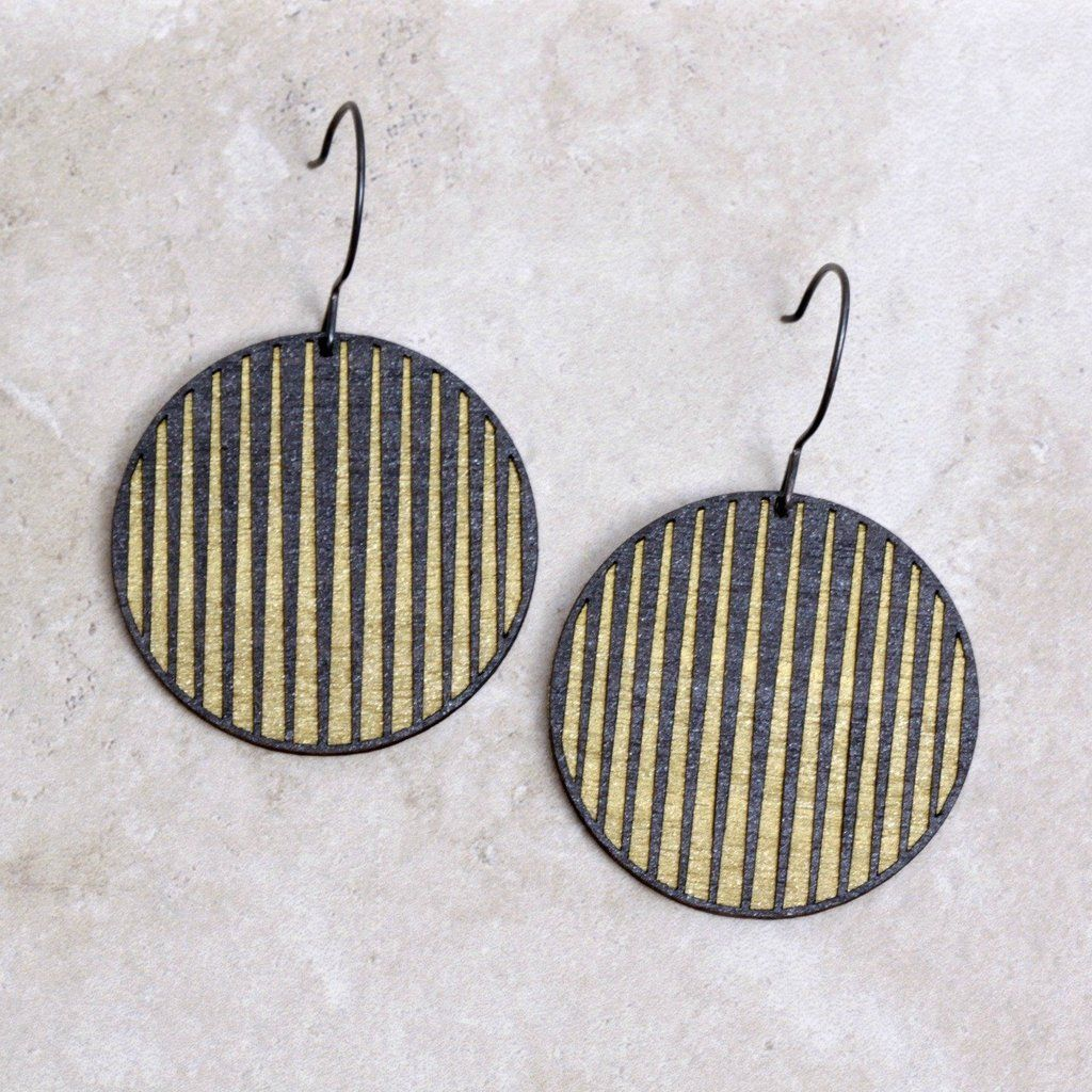 Follow the rebellious rays of the city lights as they reach their fingers up into the dark of the night sky. These Maude Earrings are handmade of _?_ painted bi