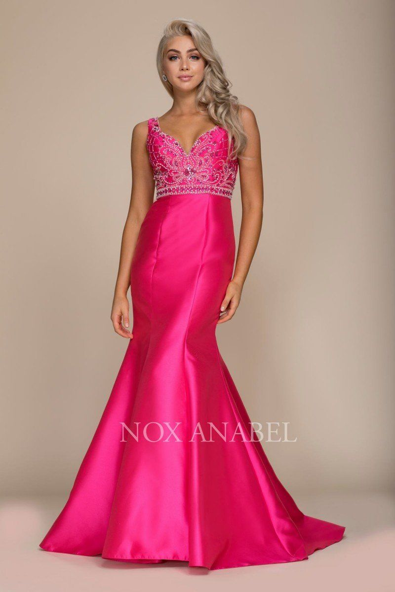 b37c2e1a2a5 Style Number  N 8307 The beaded bodice plunges in the front and back  creating a sweetheart cut. Silver Rhinestones adorn the empire waist  adjoining the ...