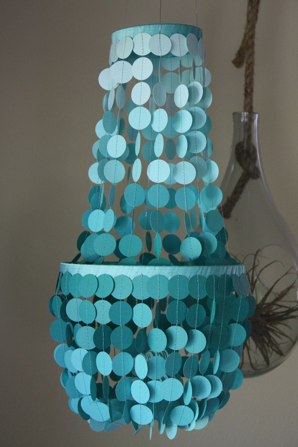 paper chandelier $37.00, via Etsy. Could probably make something like it myself