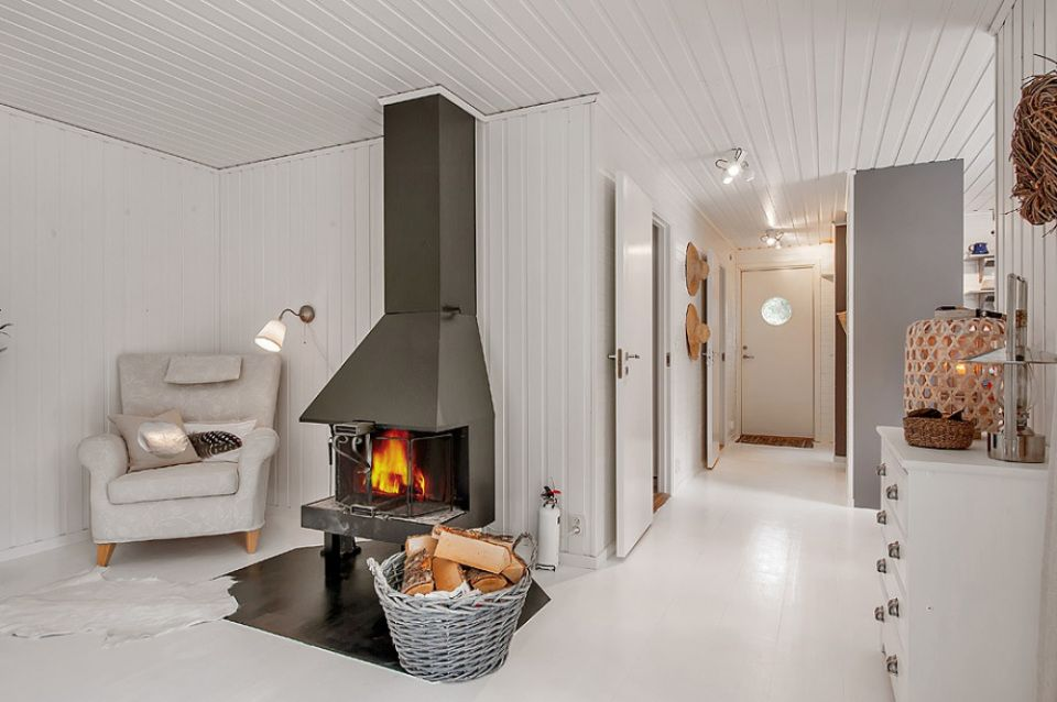This simple cottage in the Swedish countryside has 2 bedrooms. A monochromatic color scheme makes it appear more spacious than its 614 sq ft.   www.facebook.com/SmallHouseBliss