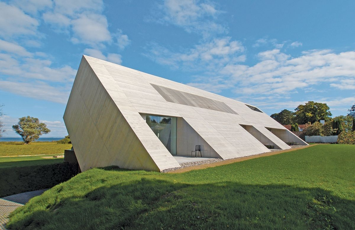 Minimalist Home With Unique Interpretation Of Gabled Roof