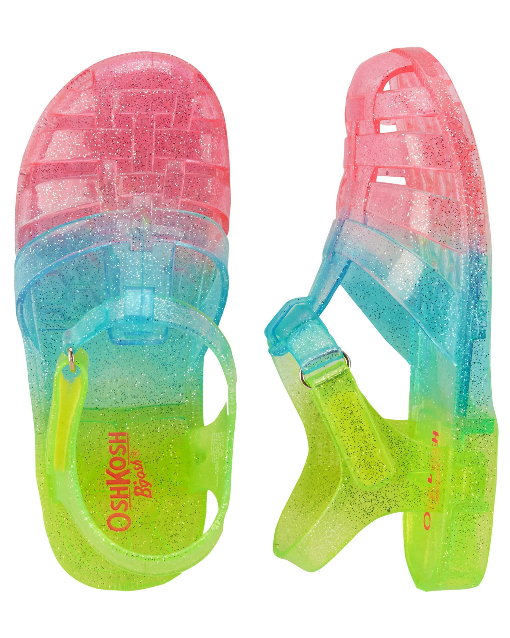 c6fac03c011f Who can say no to rainbow jelly sandals?! With a simple hook-and-loop  strap, these sandals are sure to be her new favorite shoes!