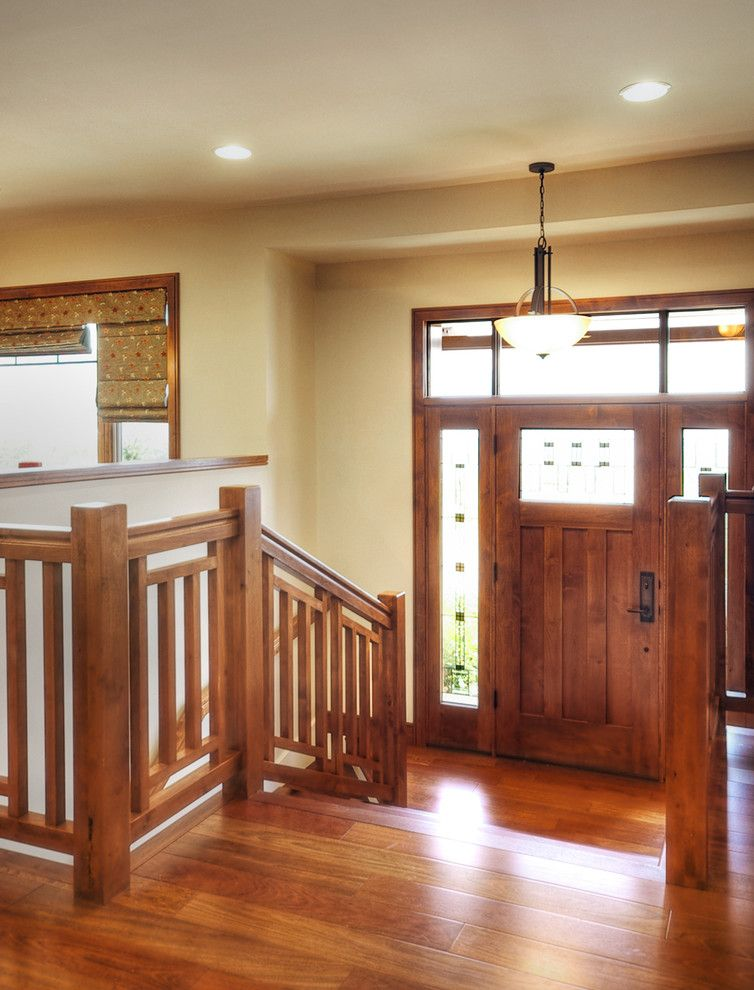 Mission style hallway idea with craftsman front door wooden stair ...