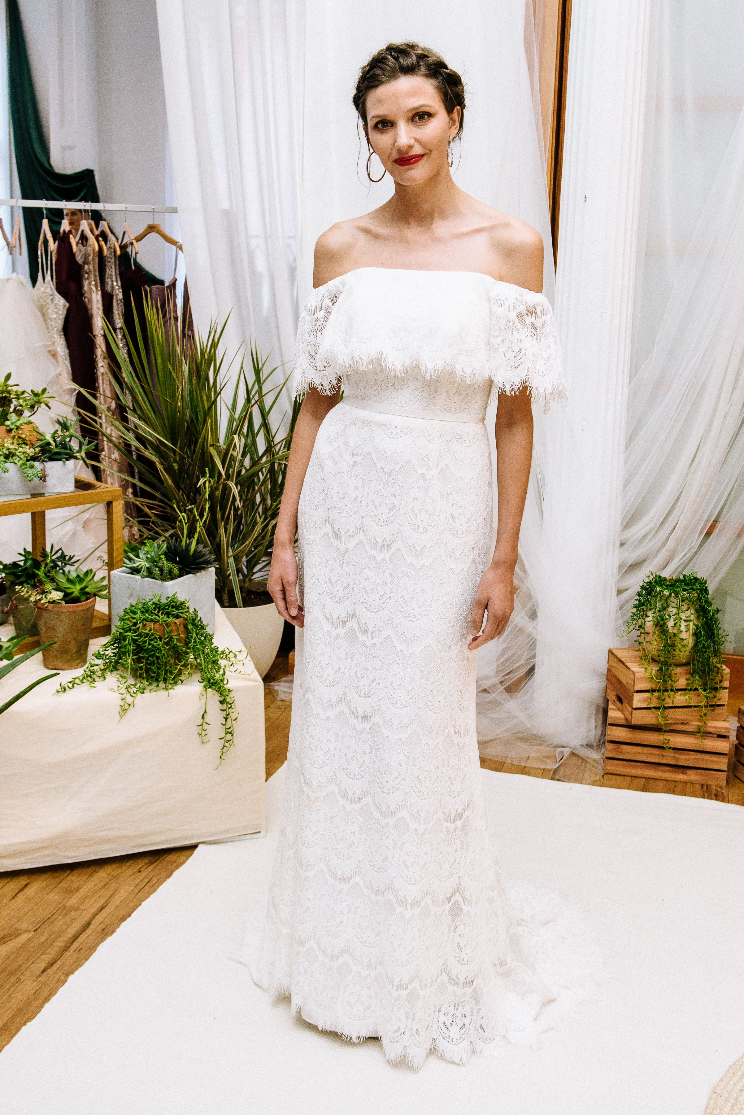 9b2476e232 A lace off the shoulder wedding dress with fringy eyelash lace from the  Galina collection at David s Bridal