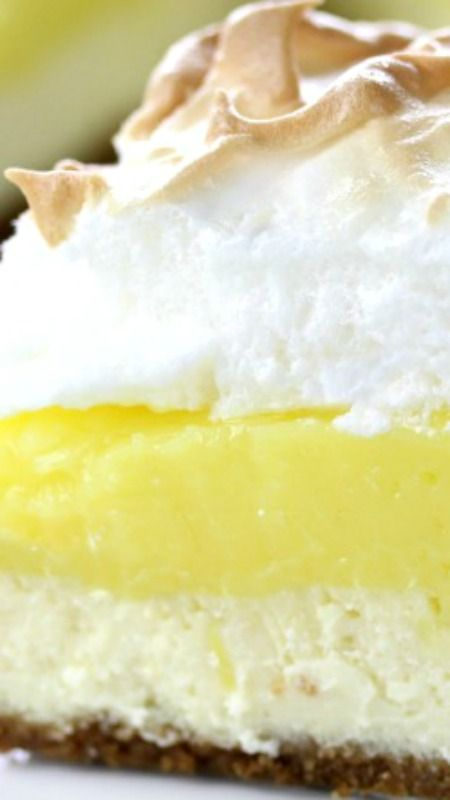 Lemon Meringue Pie Cheesecake ~ Graham crust, creamy tart lemon filling with a fluffy meringue topping.  This recipe combines all of those amazing flavors with a rich and lush cheesecake for a dessert that will top your list! #lemonmeringuecheesecake