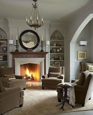 If I end up in a small house, I'm seriously considering not having a couch. I love this arrangement of chairs around the fireplace. To conserve space, I could mount my TV over the fireplace and just have 2 chairs w/a table in between, facing the fireplace and TV. Like the built-in bookshelves on the sides too.