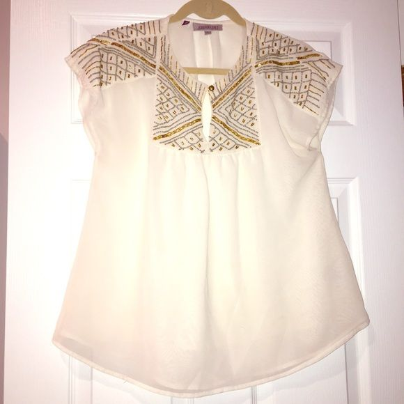 Jennifer Lopez Beaded Blouse Size small• No beads missing• 100% polyester• There is a small black mark at the bottom but barley noticeable• Other than that it's in good condition• Dress it up or down! Jennifer Lopez Tops Blouses