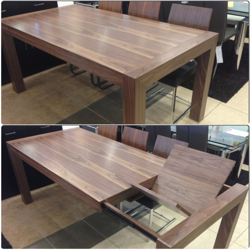 Walnut Extendable Dining Table With Butterfly Leave On Display At
