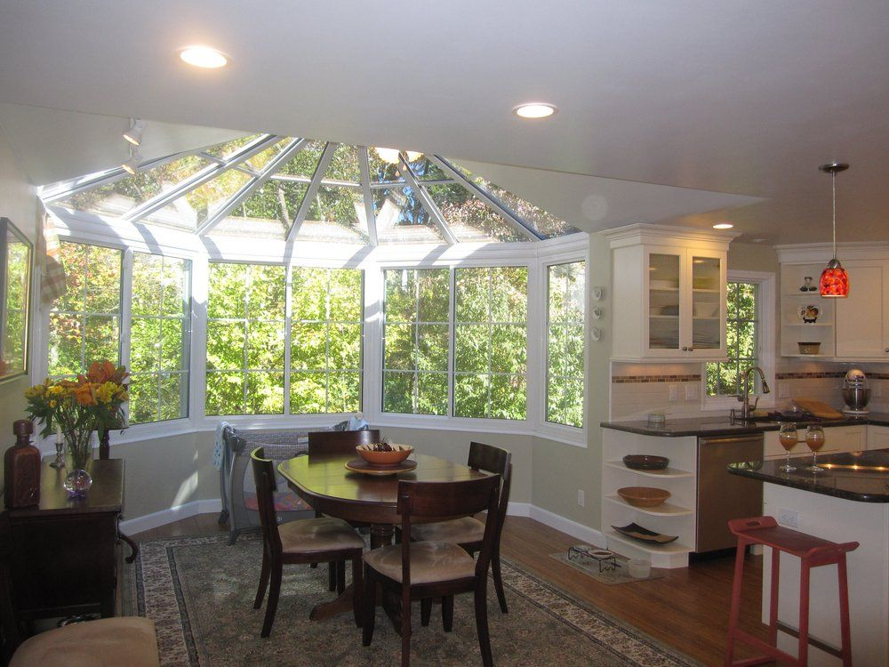 sunroom dining room adorable with using a partial sunroom addition they expanded their dining room - Sunroom Dining Room