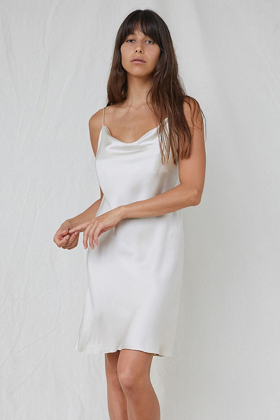 This Slip Dress Flawlessly Captures An Elegant Simplicity Made From Pure Silk Satin In Oyster White The Flattering Drape Silk Dress Short Silk Dress Dresses [ 1439 x 960 Pixel ]