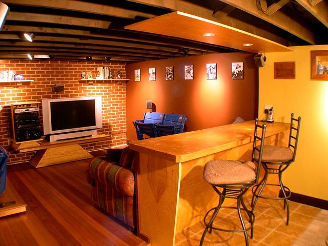 Basement Man Cave With Hardwood Flooring Man Cave Basement Man Cave Home Bar Basement Design