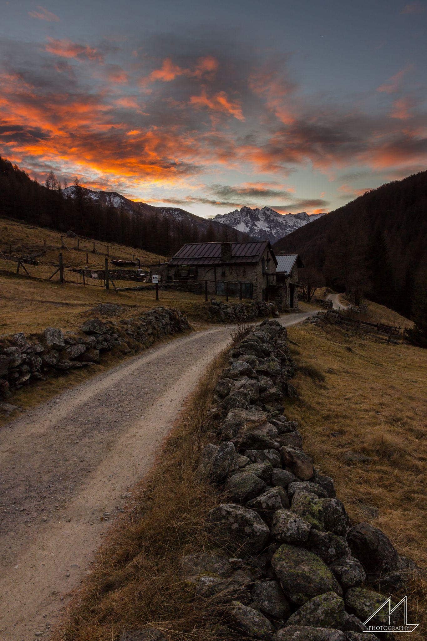 Road to the Sunrise - A fiery dawn lights over mountains Castellaccio - Stelvio National Park, Italy.  Un alba infuocata si accende sopra le montagne del Castellaccio - PN Stelvio, Ponte di Legno(BS).
