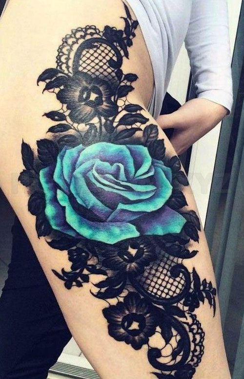Photo of Blue rose thigh tattoo