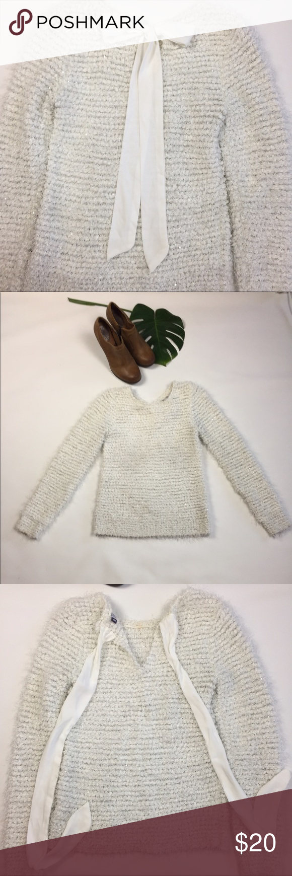 Jennifer Lopez sweater with accent bow in the back Jennifer Lopez sweater with accent bow in the back SZ XS white with shiny sequence sprinkled throughout also with longer hairlike fur throughout as accent(see close up picture) JLo Jennifer Lopez Sweaters Crew & Scoop Necks