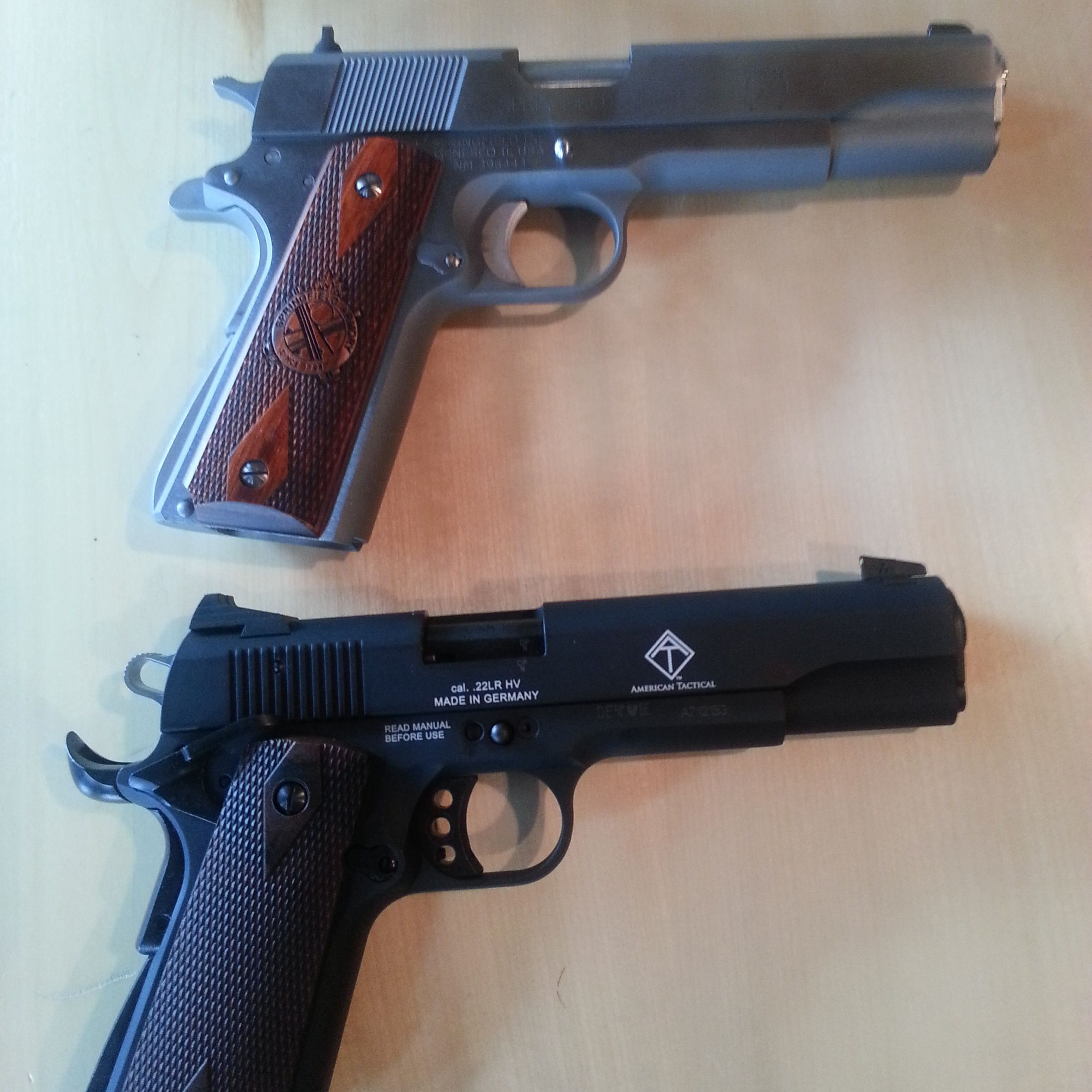 1911 Springfield Armory  45cal on top and German Sports 1911  22cal