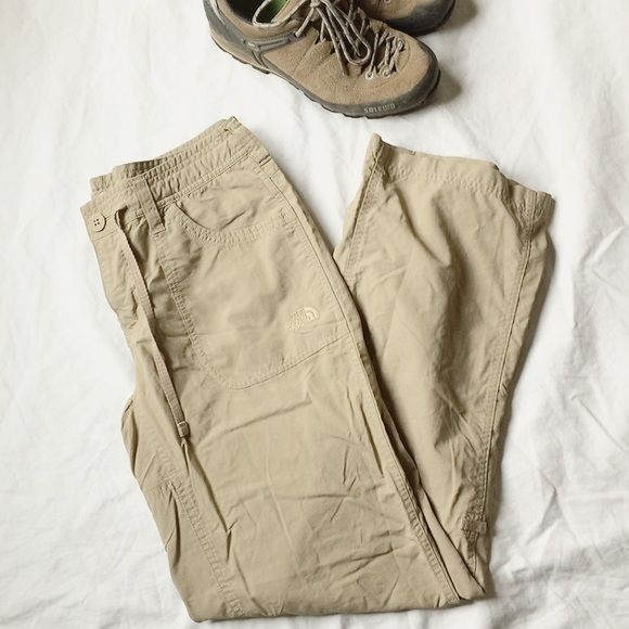 "Tan North Face outdoor camping hiking pants - sz 6 These tan North Face outdoor camping and hiking pants were worn once and are too big for me. In excellent condition and lightweight. Dark tan color best displayed in second pic. Waist 31"", rise 9"", inseam 30"". I do offers, bundles, free gifts and others deals! The North Face Pants Wide Leg"
