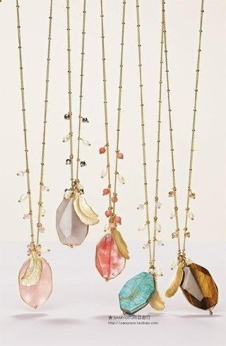 Love these handmade long gold chain necklaces by adding various raw gemstones in varieties of colors mixed with other charms like a single feather. Boho Chic in my book
