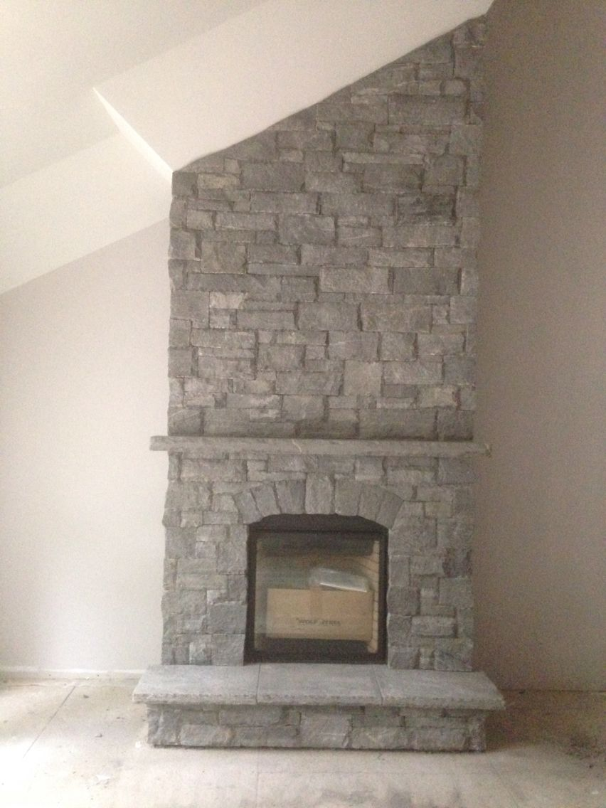 Muskoka granite large rock dry stack complete with stone hearth and