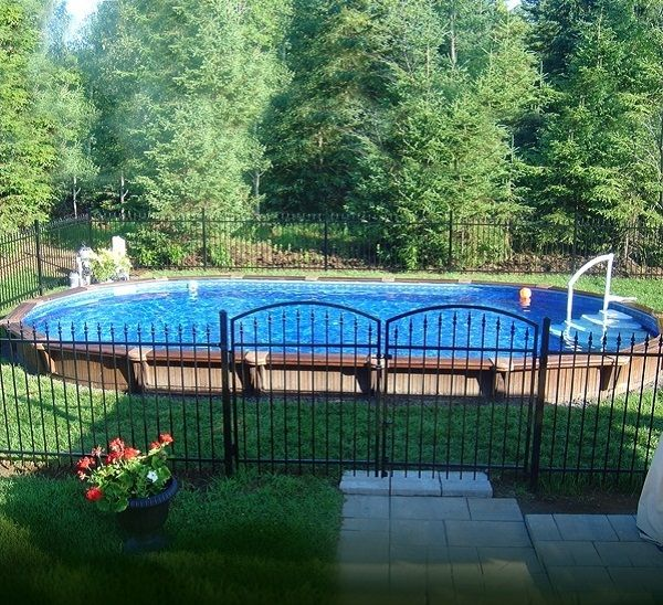 Semi Inground Pool Ideas refreshing semi inground pools with natural surroundings gorgeous semi inground pool brick wall style fence Semi Inground Pools With Green Scenery Semi Inground Pools With Black Metal Fence Housefashions
