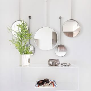 Hang Multiple Mirrors For A Dramatic Effect Mirror Wall Living Room Mirror Wall Mirror Wall Bedroom