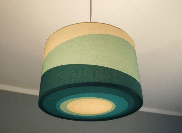 Die Lampe mit den weichen Farbwellen in verschiedenen petrolfarbenen trkisfarbenen und