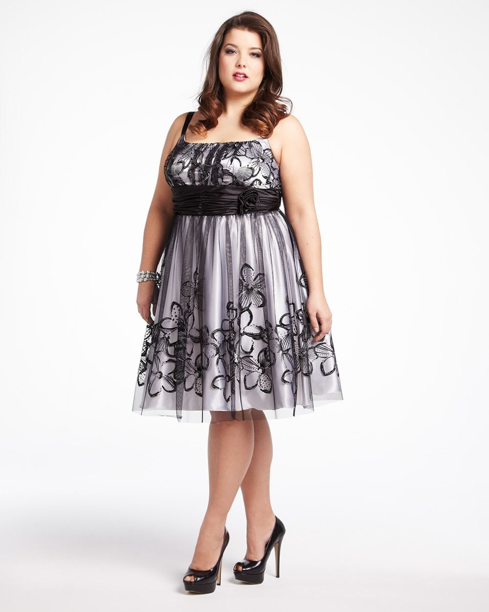 708ecd67c5 This Plus Size crinoline dress in Black For Women features a waist defining  sash waistband and adjustable spaghetti straps. Description from dawoob.com.