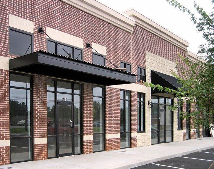 Store front metal awning with windows above awnings for Commercial aluminum storefront door