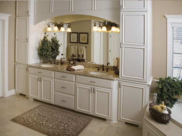 This Luxurious Master Bathroom Features Floor To Ceiling Enameled Cabinets  With Oil Rubbed Bronze Hardware · Bathroom Light FixturesBronze ...