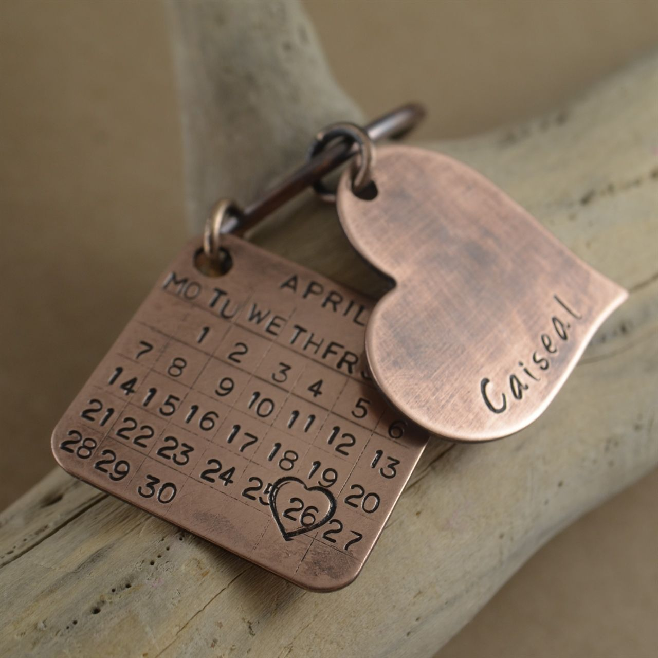 Pure Bronze Keyring with a calendar and a heart charm