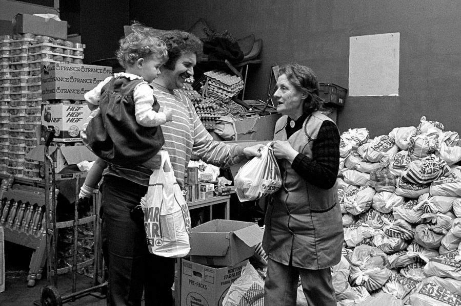 Distributing food packages to striking miners and their families - Maerdy Miners' Institute.