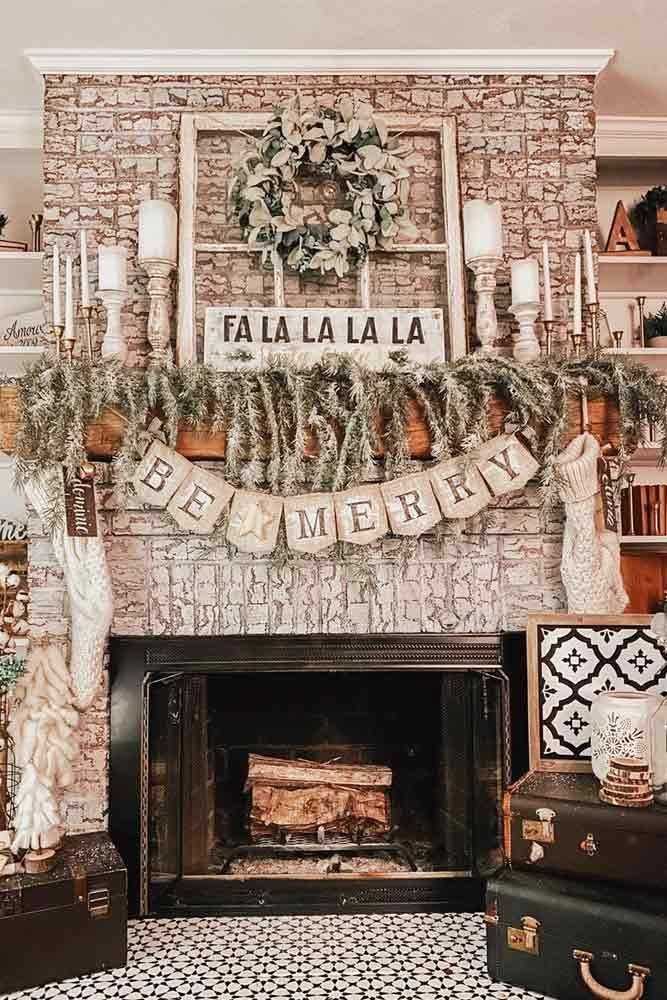 Photo of Rustic Fireplace Decor With Lettering Garlands