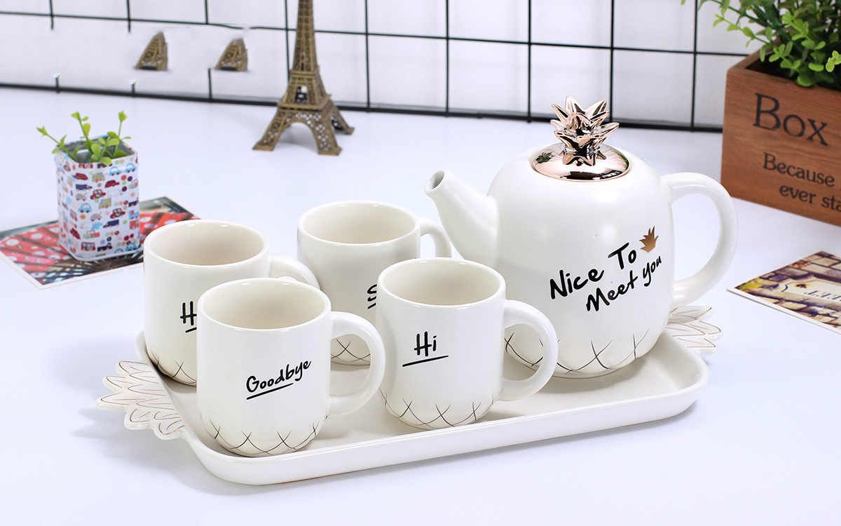 Source Cute Pineapple Design Ceramic Tea Pot Set 6 Pieces Tea Cup Set on m.alibaba.com #teapotset