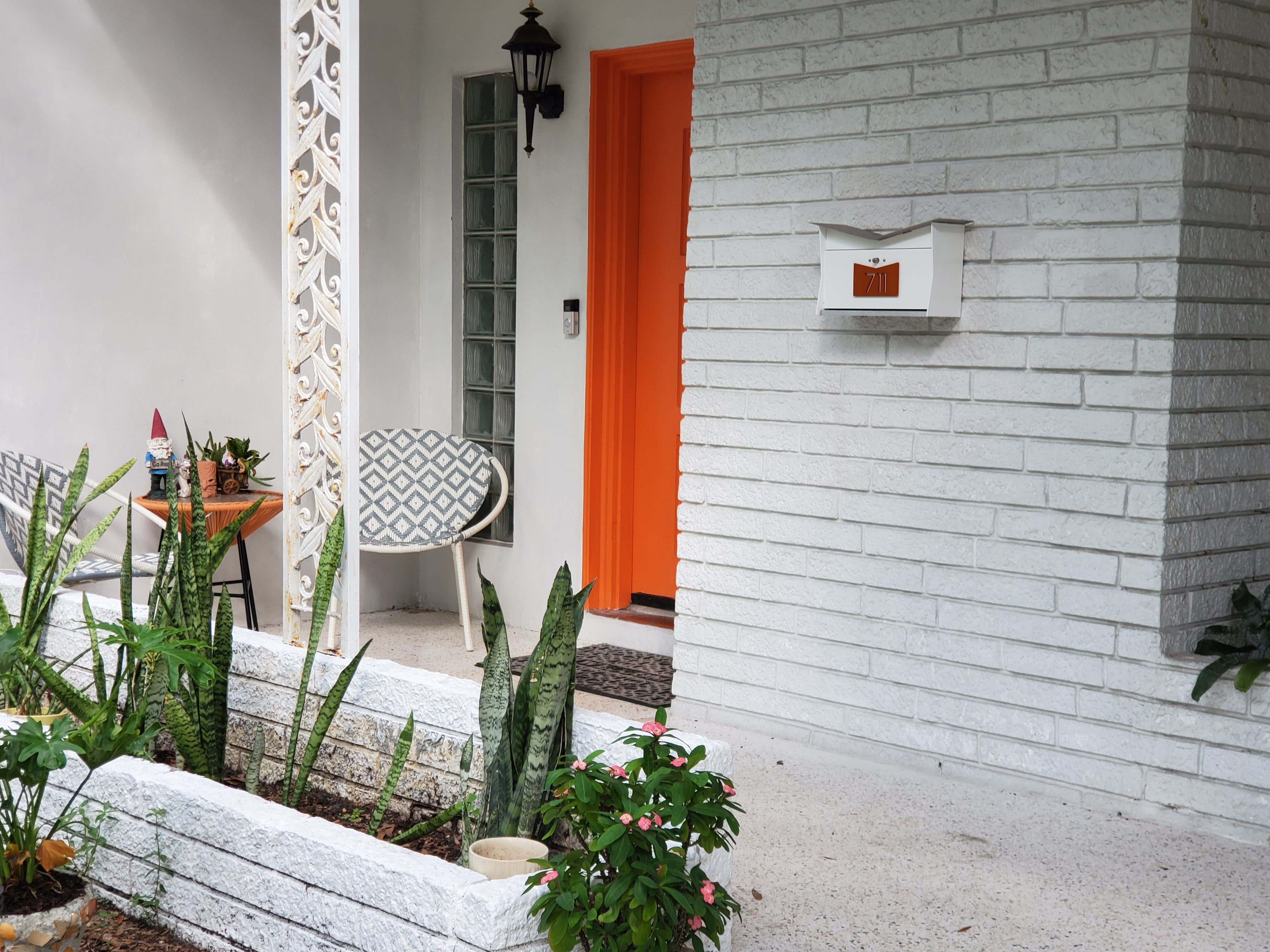 Butterfly wall mounted mailbox in arctic white and orange