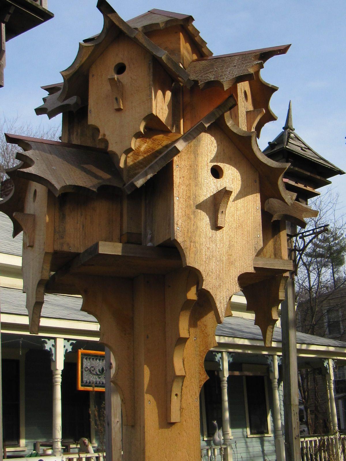 Elaborate gorgeous birdhouses.