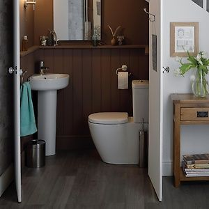 Under Stairs Bathroom Decorating Ideas an under stairs bathroom with sink and toilet | bathroom designs