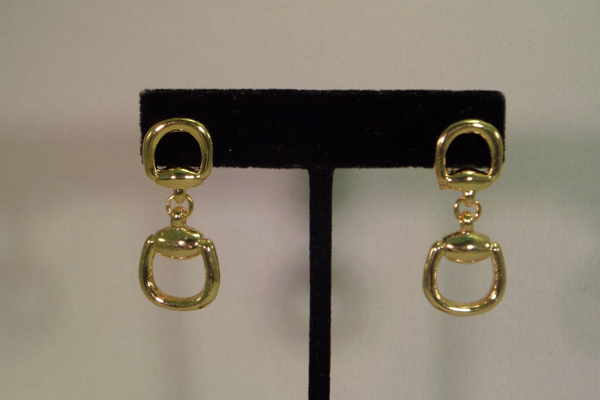 Gold horsebit dangle earrings