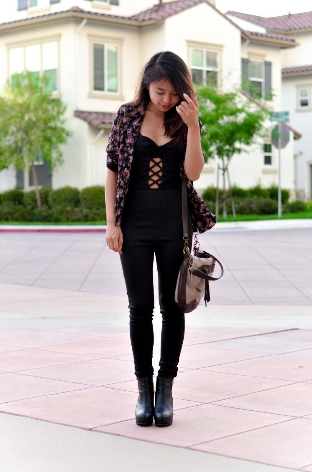 d5a4373a4e17 A black floral jacket and a black jumpsuit are a great outfit formula to  have in