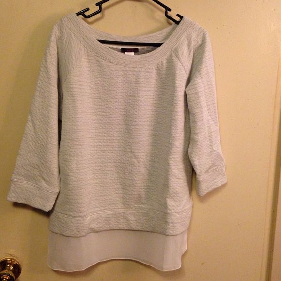 "Light gray top with sheer white under-hang Lovely light gray ""sweatshirt"" type top.  3/4 sleeves.  Has a sheer with under-hang to give it a layered look.  *runs a little small* NWOT Mark Tops"