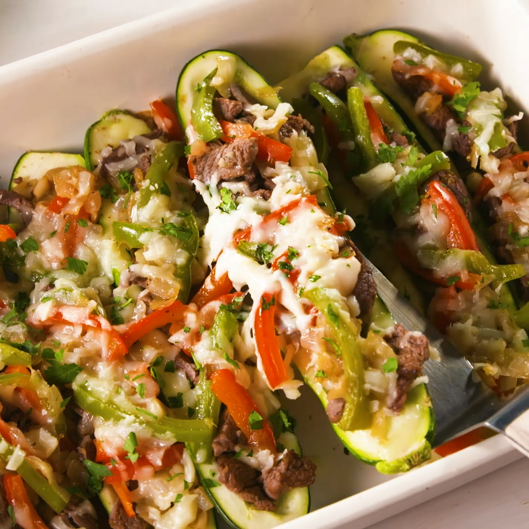 Cheesesteak Stuffed Zucchini Confession When making zucchini boats we often forget to return the scooped out zucchini back to the mixture before baking as evidenced in th...