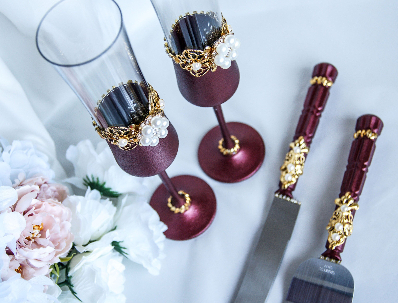 Burgundy and gold wedding flutes and cake server set