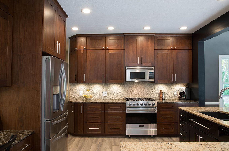 Sleek Modern Kitchen Upgrade Walnut Cabinets Beige Quartz Countertops Stone Backsplash Kitchen Remodel Kitchen Remodeling Services New Countertops